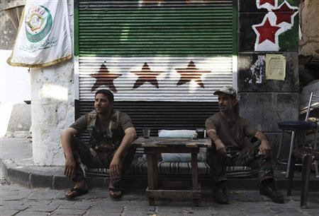 Free Syrian Army fighters sit a checkpoint in the old city of Aleppo August 20, 2013. REUTERS/Muzaffar Salman