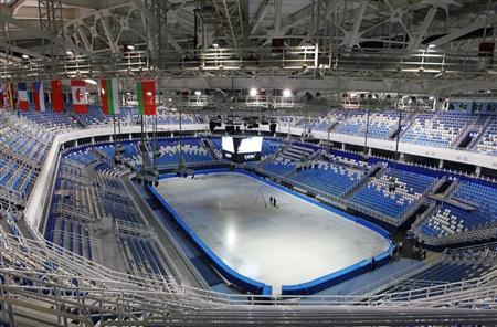 Two technicians stand on the ice as they work on the score clock at the Iceberg Skating Palace, as construction continues at the Olympic Park for the Sochi 2014 Winter Olympic Games in Adler August 20, 2013. The arena will be used for figure skating and short track speed skating when the Sochi 2014 Winter Olympics opens next February. REUTERS/Gary Hershorn