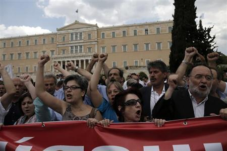 Anti-austerity protesters and parliamentarians of the anti-bailout radical leftist SYRIZA party participate in a rally in Athens, July, 16, 2013, during a 24-hour general strike. REUTERS-John Kolesidis