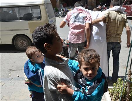 Children who survived what activists say is a gas attack is seen along a street in the Duma neighbourhood of Damascus August 21, 2013. REUTERS/Bassam Khabieh