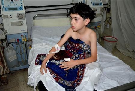 A boy, affected by what activists say is nerve gas, is treated at a hospital in the Duma neighbourhood of Damascus August 21, 2013. REUTERS/Bassam Khabieh
