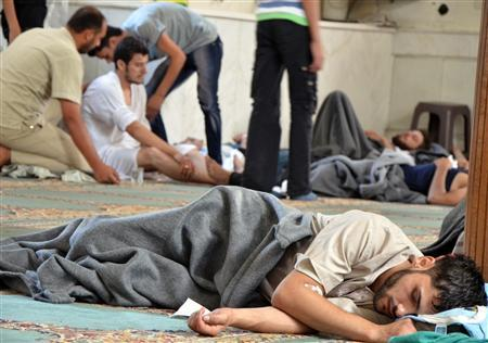 A survivor from what activists say is a gas attack rests inside a mosque in the Duma neighbourhood of Damascus August 21, 2013. REUTERS/Bassam Khabieh