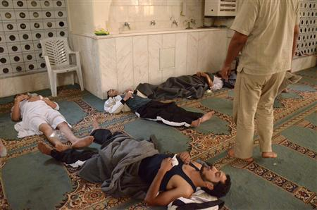 Survivors from what activists say is a gas attack rest inside a mosque in the Duma neighbourhood of Damascus August 21, 2013. REUTERS-Bassam Khabieh