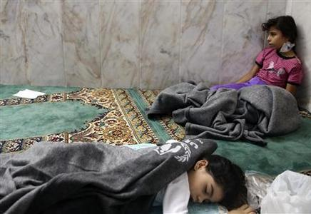 Girls who survived from what activists say is a gas attack rest inside a mosque in the Duma neighbourhood of Damascus August 21, 2013. REUTERS-Mohamed Abdullah