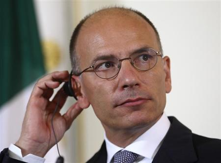 Italy's Prime Minister Enrico Letta listens during a news conference in Vienna August 21, 2013. REUTERS/Heinz-Peter Bader