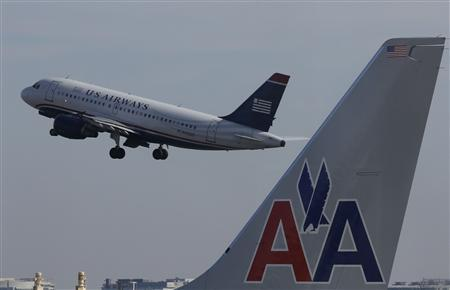 A U.S. Airways jet departs Washington's Reagan National Airport next to American Airlines jets outside Washington, in this February 25, 2013 file photo. REUTERS/Larry Downing/Files