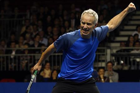 John McEnroe of the U.S. reacts after winning a point during his BNP Paribas Showdown friendly tennis match against compatriot Ivan Lendl in Hong Kong March 4, 2013. REUTERS/Tyrone Siu