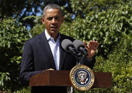U.S. President Barack Obama makes a statement about the violence in Egypt while at his rental vacation home on the Massachusetts island of Martha's Vineyard in Chilmark August 15, 2013. REUTERS/Larry Downing