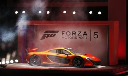 A McLaren P1 is showcased during a presentation for the game ''Forza Motorsport 5'' during the Xbox E3 Media Briefing at USC's Galen Center in Los Angeles, California June 10, 2013. REUTERS/Mario Anzuoni