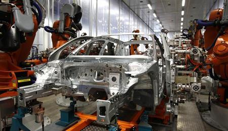Robots connect side parts on an Audi A3 light weight construction chassis at the production line of the German car manufacturer's plant in the Bavarian city of Ingolstadt April 11, 2013. REUTERS/Michaela Rehle