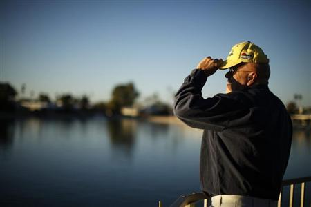 A senior citizen looks out to a lake in Sun City, Arizona, January 4, 2013. REUTERS/Lucy Nicholson