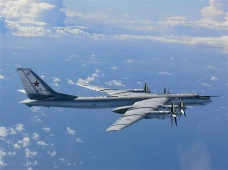 A Russian TU-95 bomber flies through airspace northwest of Okinoshima island, Fukuoka prefecture in the southern island of Kyushu, in this handout picture taken by Japan Air Self-Defence Force and released by the Defense Ministry of Japan August 22, 2013. REUTERS/Defense Ministry of Japan/Handout via Reuters