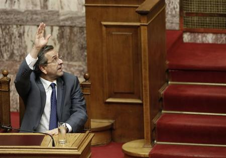 Greece's Prime Minister Antonis Samaras votes during a parliament vote on a series of reforms that must be passed before the European Union and International Monetary Fund can disburse more financial aid, in Athens July 18, 2013. REUTERS/John Kolesidis