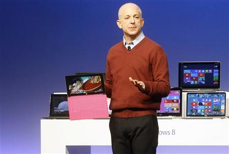 Windows' and Windows Live Division President, Steven Sinofsky, holds a Surface tablet computer as he introduces the new Windows 8 operating system during a promotional event before the launch of Windows 8, in Shanghai October 23, 2012. REUTERS/China Daily