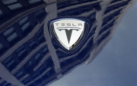 A logo of Tesla Motors on an electric car model is seen outside a showroom in New York June 28, 2010. REUTERS/Shannon Stapleton