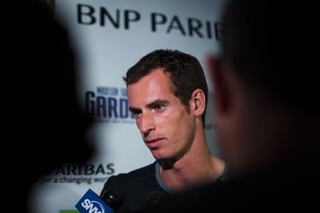 Tennis player Andy Murray of Britain speaks with the media as he attends an event announcing his participation in the 7th annual BNP Paribas Showdown in New York August 19, 2013 file photo. REUTERS/Eduardo Munoz