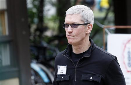 Tim Cook, Apple CEO walks past a news conference being held by Eric Schmidt, executive chairman of Google at the annual Allen and Co. conference in Sun Valley, Idaho Resort July 11, 2013. REUTERS/Rick Wilking