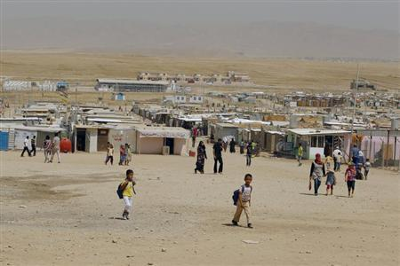 Syrian refugees, who fled the violence back home, are seen at the Domiz refugee camp in the northern Iraqi province of Dohuk, August 21, 2013. REUTERS/Thaier al-Sudani