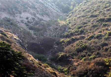 A view shows the site which Popular Front for the Liberation of Palestine (PFLP) said was hit by an Israeli rocket near Na'ameh, south of Beirut, near a network of tunnels used by PFLP in hills overlooking the Mediterranean coast, August 23, 2013. REUTERS/Mohamed Azakir