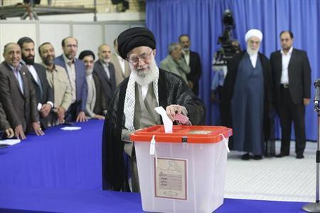 Iran's Supreme Leader Ayatollah Ali Khamenei casts his ballot at his office during the Iranian presidential election in central Tehran June 14, 2013. REUTERS/Fars News/Hassan Mousavi