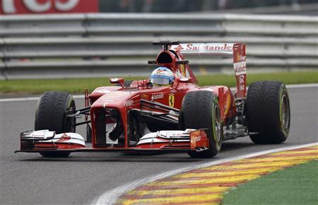 Ferrari Formula One driver Fernando Alonso of Spain takes a curve during the first practice session of the Belgian F1 Grand Prix at the Circuit of Spa-Francorchamps August 23, 2013. REUTERS/Laurent Dubrule