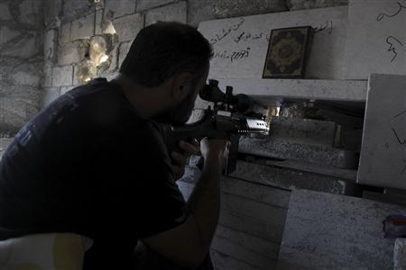 A Free Syrian Army fighter takes up a shooting position in the Salah al-Din neighbourhood of central Aleppo August 22, 2013. REUTERS/Loubna Mrie