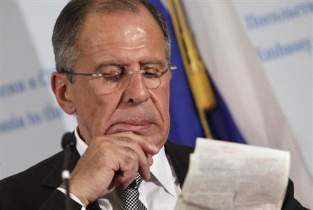 Russia's Foreign Minister Sergey Lavrov reads notes during a news conference at the Russian embassy in Washington after a meeting with U.S. Secretary of State John Kerry and Secretary of Defense Chuck Hagel, August 9, 2013. REUTERS/Yuri Gripas