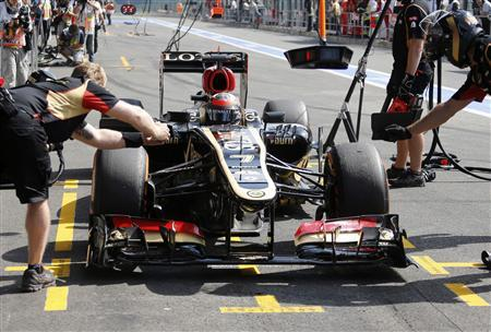 Lotus Formula One driver Kimi Raikkonen of Finland drives into the pit during the second practice session of the Belgian F1 Grand Prix at the Circuit of Spa-Francorchamps August 23, 2013. REUTERS/Francois Lenoir