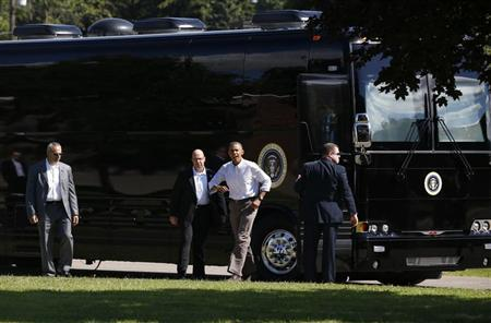 U.S. President Barack Obama steps off his bus upon his arrival at Tully Central High School in Tully, New York August 23, 2013. REUTERS/Jason Reed