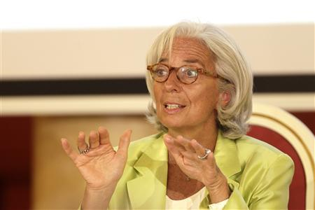 International Monetary Fund (IMF) managing director Christine Lagarde gestures as she speaks during the debate ''European Economic Integration: Challenges and Opportunities'' in Vilnius July 18, 2013. REUTERS/Ints Kalnins