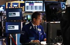 A trader works on the main trading floor of the New York Stock Exchange (NYSE) shortly after the opening bell in New York, May 20, 2013. REUTERS/Mike Segar