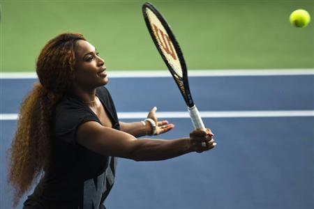 Serena Williams of the U.S. returns a ball while she attends an exhibition game after the Draw Ceremony before the start of the 2013 U.S. Open tennis tournament at the USTA Billie Jean King National Tennis Center in New York, August 22, 2013. REUTERS/Eduardo Munoz