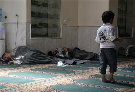 Survivors from what activists say is a gas attack rest inside a mosque in the Duma neighbourhood of Damascus August 21, 2013. REUTERS/Bassam Khabieh