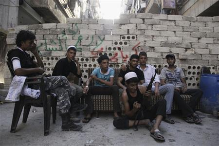 Free Syrian Army fighters rest in Salah al-Din neighbourhood in central Aleppo August 24, 2013. REUTERS/Loubna Mrie
