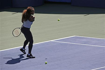 Reigning U.S. Open champion Serena Williams participates in a skills competition during Arthur Ashe Kids' Day at the USTA Billie Jean King National Tennis Center in New York August 24, 2013. REUTERS/Eric Thayer