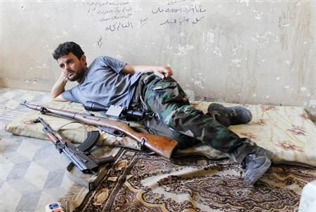 A Free Syrian Army fighter rests next to his weapons in al-Swaika district in Aleppo August 24, 2013. REUTERS/Molhem Barakat