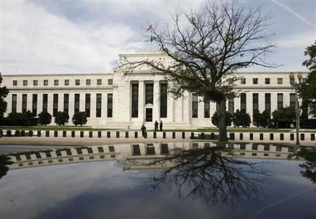 The Federal Reserve Building is reflected on a car in Washington September 16, 2008. REUTERS/Jim Young