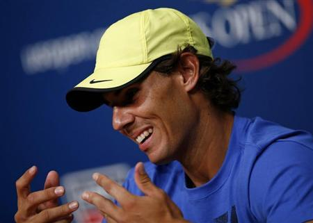 Tennis player Rafael Nadal of Spain speaks during a news conference after Arthur Ashe Kids' Day at the USTA Billie Jean King National Tennis Center in New York August 24, 2013. REUTERS/Eric Thayer