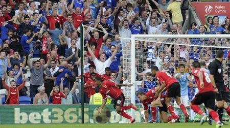 Cardiff City's Fraizer Campbell (L) celebrates after scoring a goal against Manchester City, during their English Premier League soccer match at Cardiff City Stadium, Cardiff, Wales August 25, 2013. REUTERS/Rebecca Naden