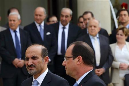 French President Francois Hollande (R) and with Ahmad Jarba (L), head of the opposition Syrian National Coalition, speak to journalists at the Elysee Palace in Paris, July 24, 2013. REUTERS/Philippe Wojazer