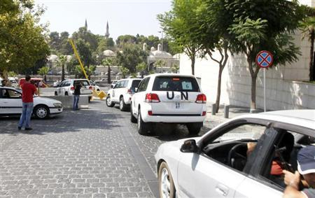 United Nations (U.N.) vehicles transport a team of U.N. chemical weapons experts to the scene of a poison gas attack outside the Syrian capital last week, in Damascus August 26, 2013. REUTERS/Khaled al-Hariri