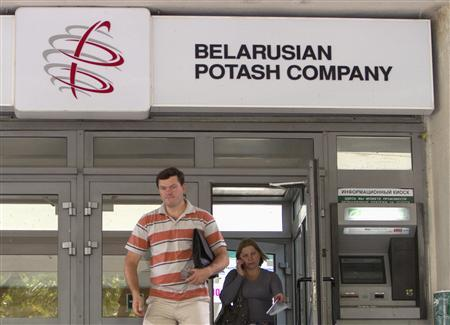 People walk out from an office of the Belarusian Potash company in Minsk, August 26, 2013. REUTERS/Vasily Fedosenko