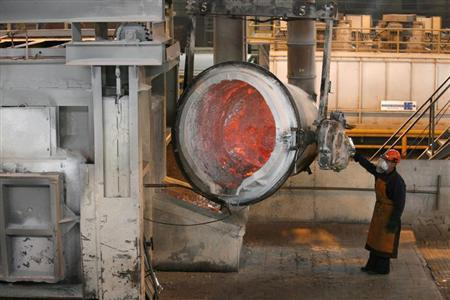 A worker operates a mixer of fused aluminium at the foundry shop of the Rusal Sayanogorsk aluminium smelter outside the town of Sayanogorsk, some 480 km (298 miles) south of the Siberian city of Krasnoyarsk, August 21, 2013. REUTERS/Ilya Naymushin