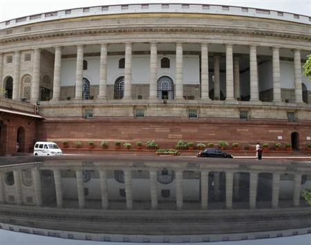 A view of the parliament building is reflected on a car in New Delhi April 24, 2012. REUTERS/B Mathur/Files