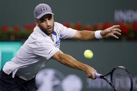 James Blake of the U.S. returns a shot against Jo-Wilfried Tsonga of France during their match at the BNP Paribas Open ATP tennis tournament in Indian Wells, California, March 10, 2013. REUTERS/Danny Moloshok