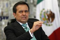 Mexican Economy Minister Ildefonso Guajardo gestures as he speaks during an interview with Reuters at his office in Mexico City August 16, 2013. REUTERS/Tomas Bravo