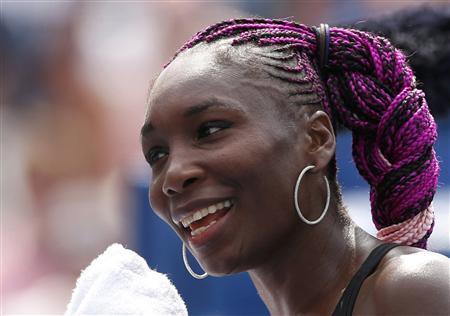 Venus Williams of the U.S. smiles after her victory over Kirsten Flipkens of Belgium at the U.S. Open tennis chammpionships in New York, August 26, 2013. REUTERS/Mike Segar