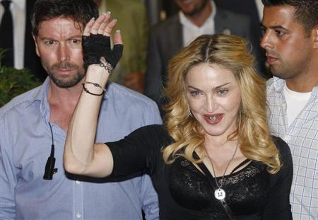 U.S. singer Madonna waves as she leaves the new Hard Candy Fitness centre in downtown Rome August 21, 2013. REUTERS/Remo Casilli