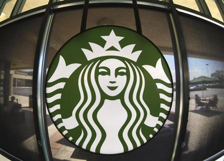 The Starbucks logo hangs on a window inside a newly designed Starbucks coffee shop in Fountain Valley, California August 22, 2013. REUTERS/Mike Blake