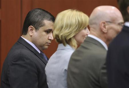George Zimmerman looks down as his defense team Don West (R), and Lorna Truett (C), react upon hearing the verdict in Zimmerman's 2012 shooting death of Trayvon Martin at the Seminole County Criminal Justice Center in Sanford, Florida, July 13, 2013. REUTERS/Joe Burbank/Pool